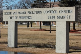 Photo of the North End Water Pollution Control Centre sign, with address of 2230 Main Street below