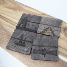 A set of wooden coasters, each featuring a different scene from Lake Winnipeg