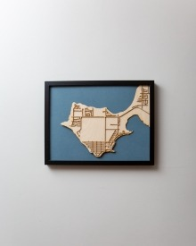 A lakeside community map laser-cut from Baltic birch made by Jill Patrick.