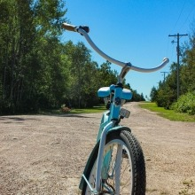 A vintage bicycle sitting on a gravel road at Victoria Beach, Manitoba